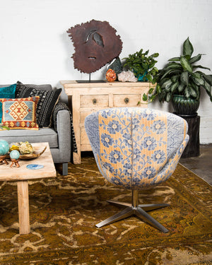 "Mid-century style ""swan"" chair covered in vintage kantha textiles"