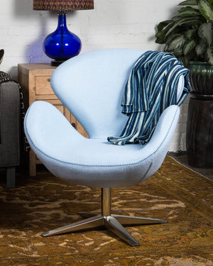 "Mid-century style ""swan"" chair, covered in light sky blue wool"