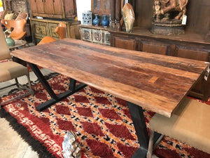 Live edge dining table made from reclaimed Indian hardwoods on an iron base