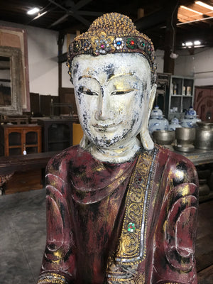 Thai carved wood Buddha figure holding a bowl