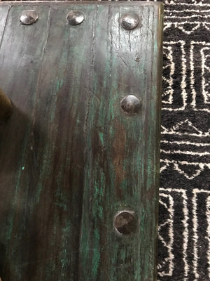 Vintage Indian teak door mounted on a work table base, now a coffee table