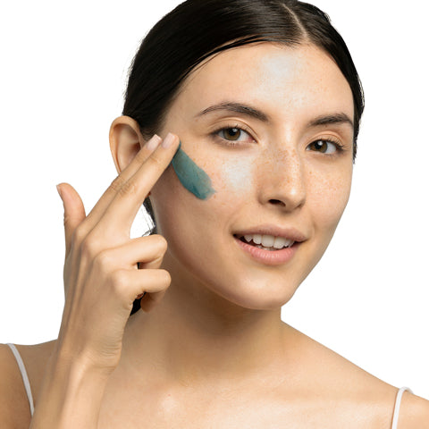 Model applying Blue Algae Vitamin C Dark Spot Correcting Peel