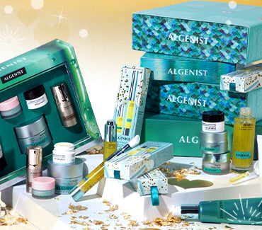 Pile of Algenist gift boxes