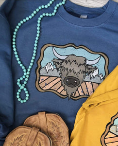 "Shipping Dept. ""HIGHLAND COW and the MOUNTAINS"" on BLUE SWEATSHIRT - THE ROAMING SAGUARO COLLECTION by Meghan Wolff"