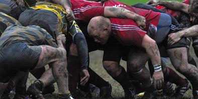 Rugby players in a muddy scrum