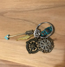 Compass key chain with charms
