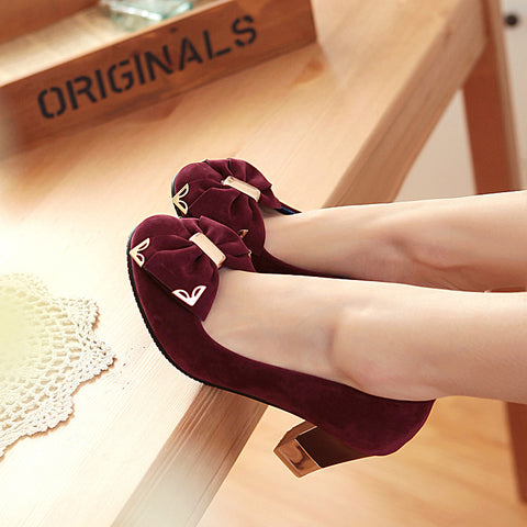 Round toe high-heeled pumps