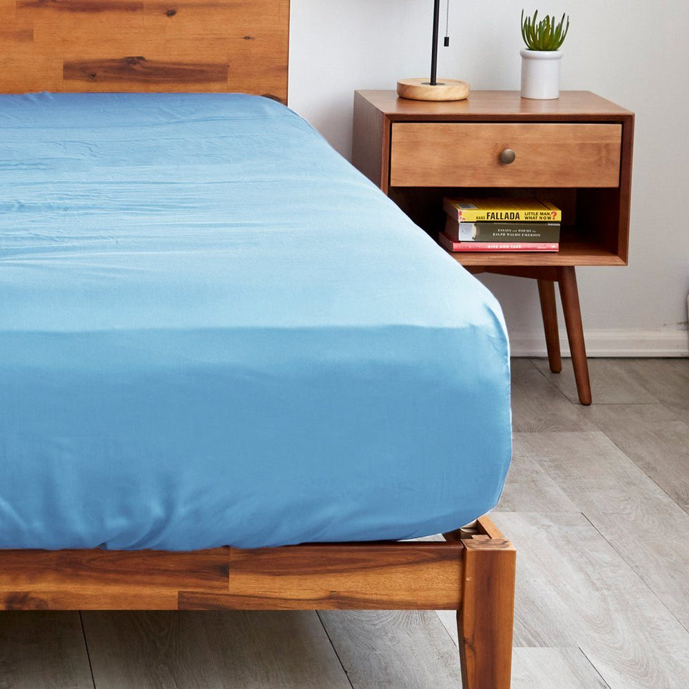 Our light blue fitted sheets with extra deep pockets that fit mattresses up to 20