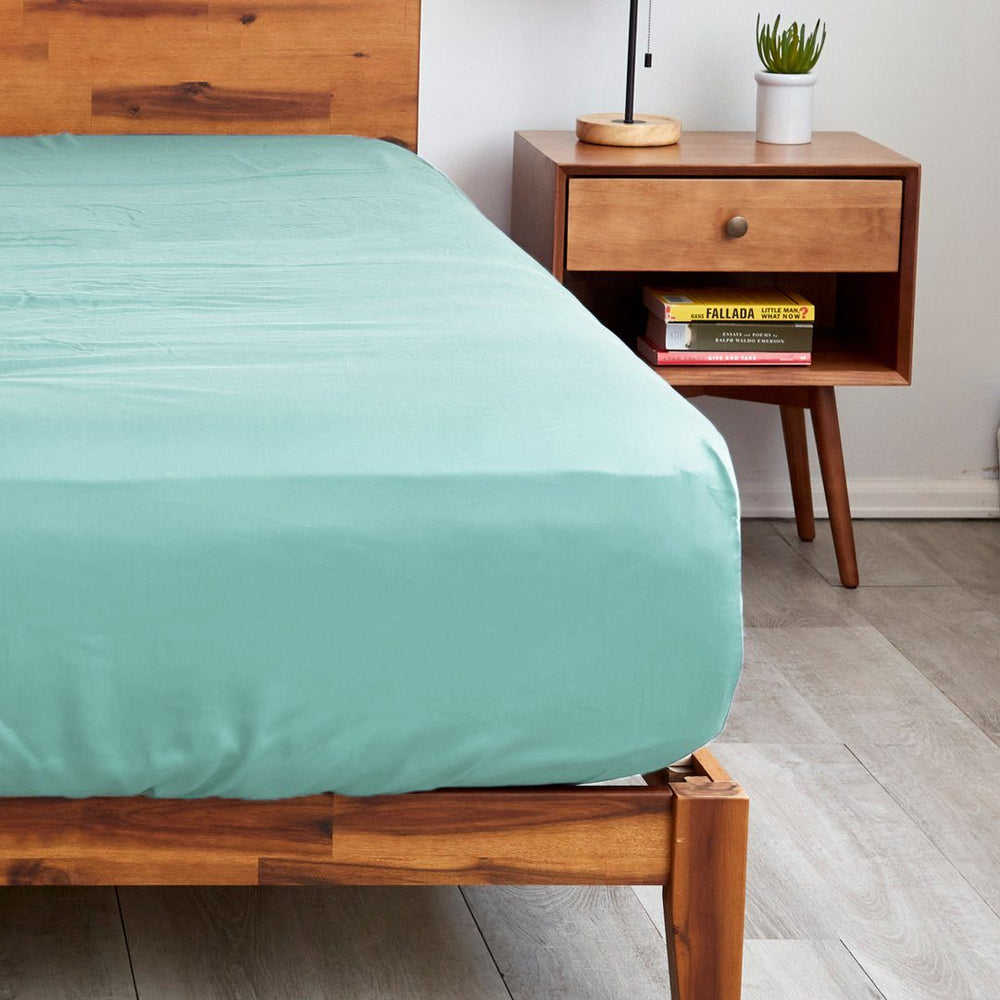Our mint green fitted sheets with extra deep pockets that fit mattresses up to 20