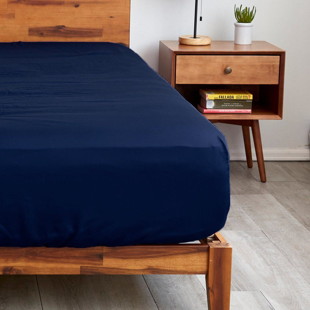 Sheets & Giggles navy blue fitted sheets with extra deep pockets that fit mattresses up to 20