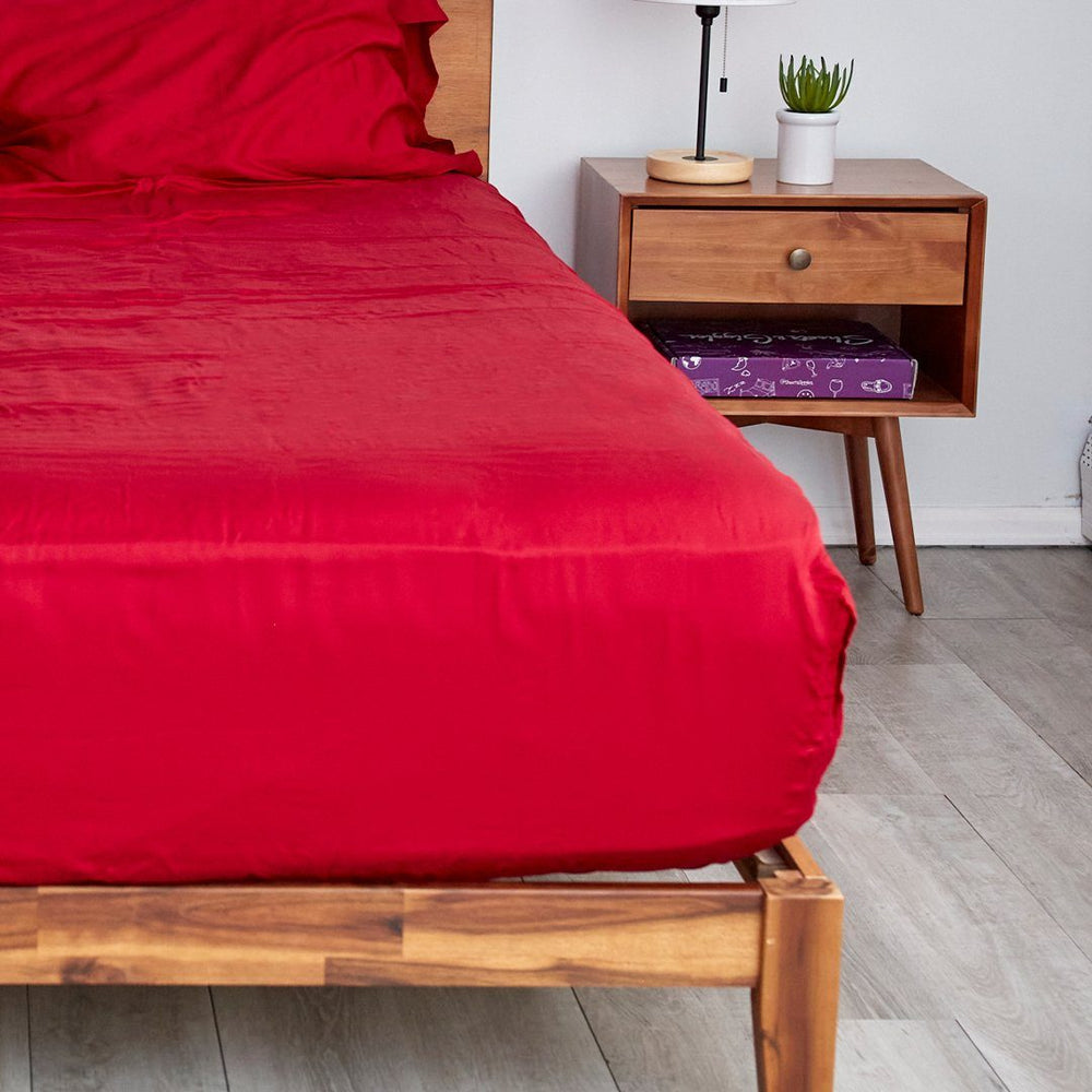 Our red fitted sheets with extra deep pockets that fit mattresses up to 20