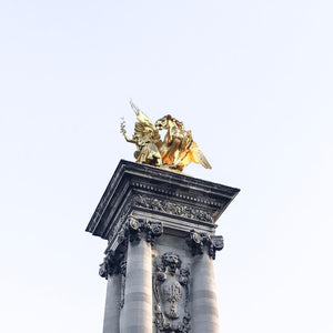 Golden Statue Atop a Column by S Ramgarhia