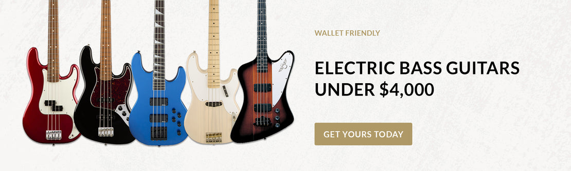 A variety of electric bass guitars