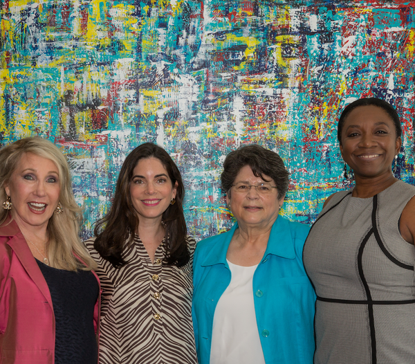"""United"" painting by artist Ruth Mansmith with Xiomi Penn, Mauri Murray and Marcelle Burke"