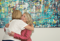 """United"" painting with Mayor Jeri Muoio and artist Ruth Mansmith"