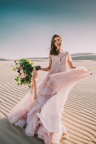 Blush pink wedding dress. This statement ballgown is one of many wedding dresses from She Wore Flowers.