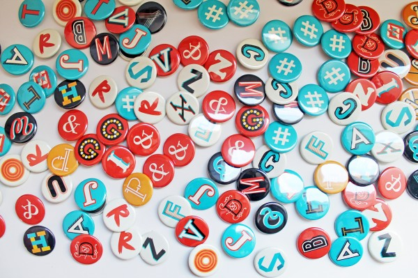 Typografie button - J