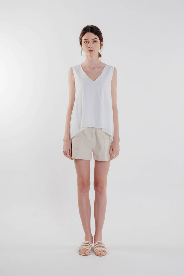Two-way Asymmetrical Top in White