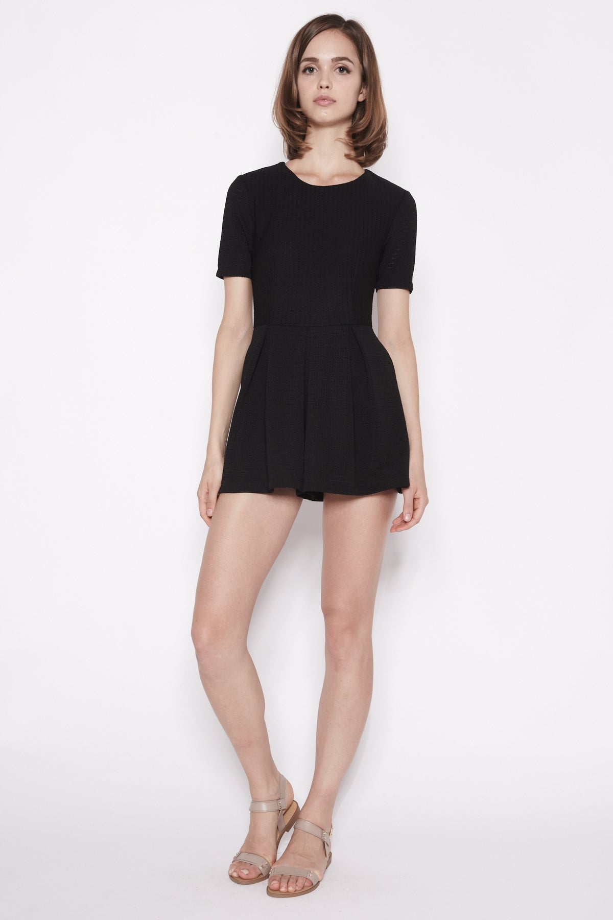 Cut-Out Back Textured Romper In Black