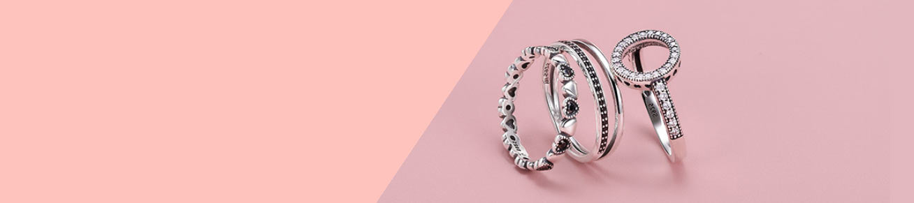 4 silver stacking rings consisting of hearts & cubic zirconia