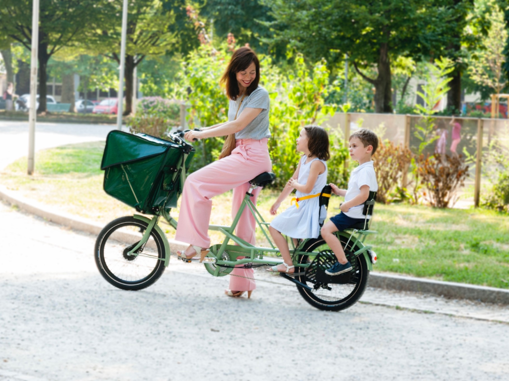 mariangela with her children in a bike