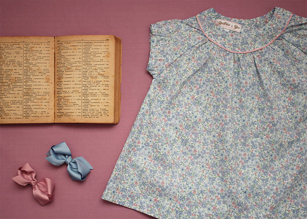 floral blouse with vintage book and hair bows