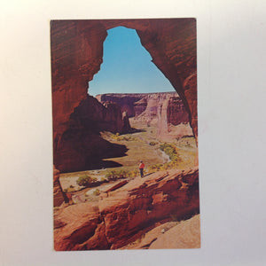 Vintage Color Postcard Man Standing Beneath The Window at Canyon de Chelly National Monument Chinle Arizona