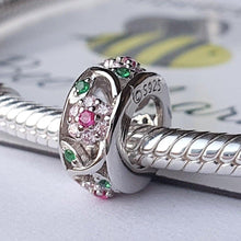 Flower Spacer- 925 Sterling Silver stamped & Cubic Zircons, can fit on most charm bracelets (Including Pandora) or a necklace.