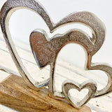 Double Silver Finish Heart On  Wooden Base