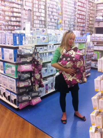 Nursing while checking on our product display in Buy Buy Baby