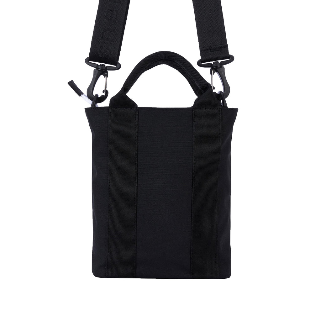 Black Convertible Crossbpdy bag and Mini Tote (back view) made with recycled materials