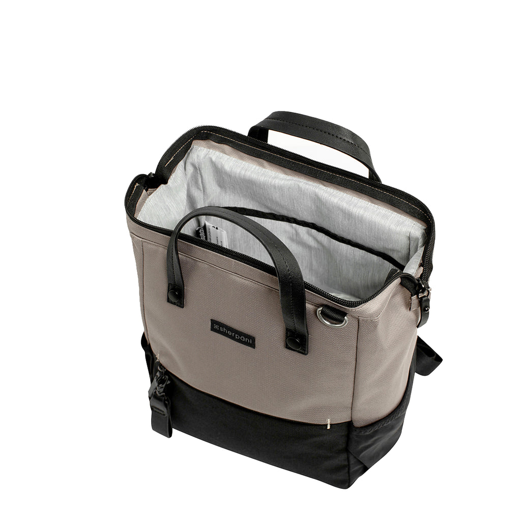 Light tan Handbag/Crossbody/Backpack (interior main zipper compartment) made with recycled materials