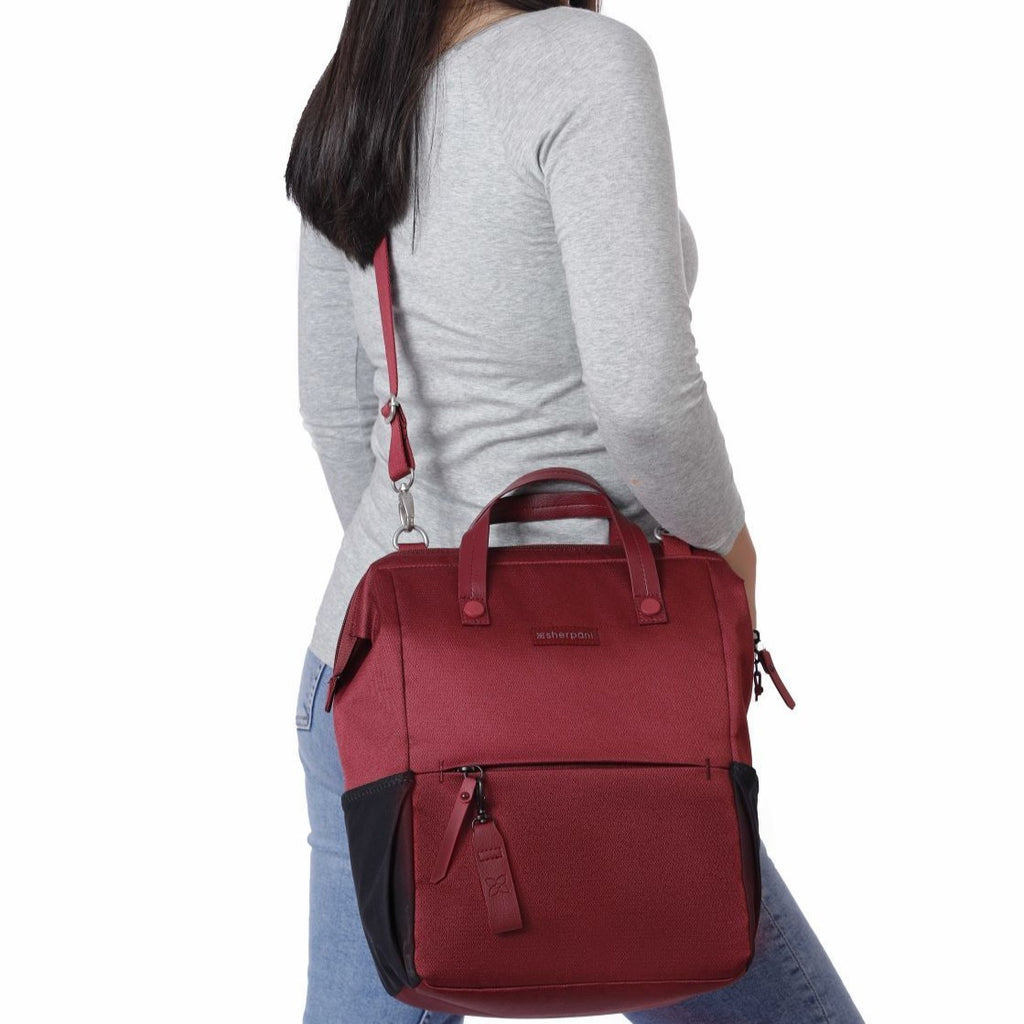 Red Handbag/Crossbody/Backpack (worn as crossbody) made with recycled materials
