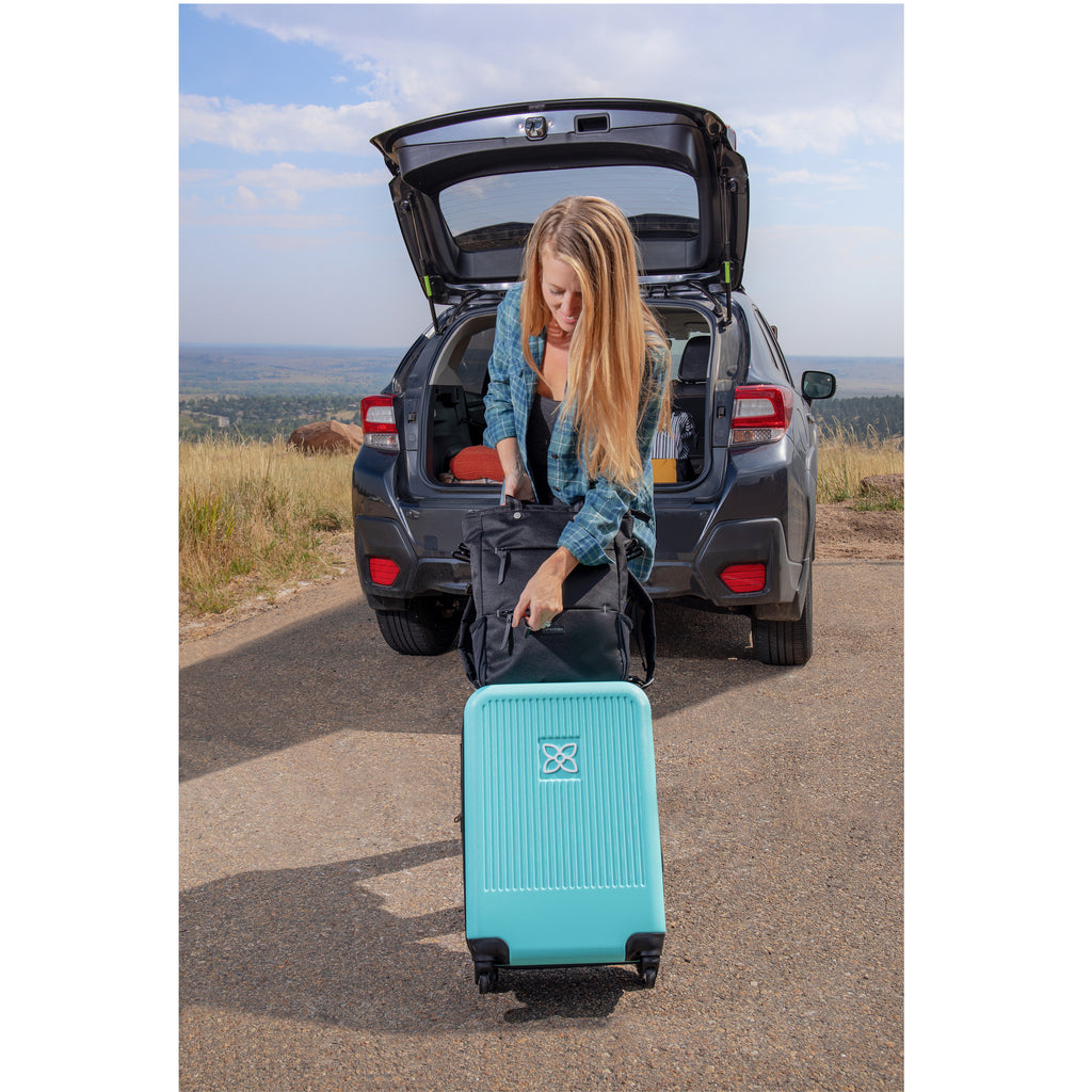 Blue Crushproof Carryon Luggage made with ultra lightweight materials on a trip with Camden Raven
