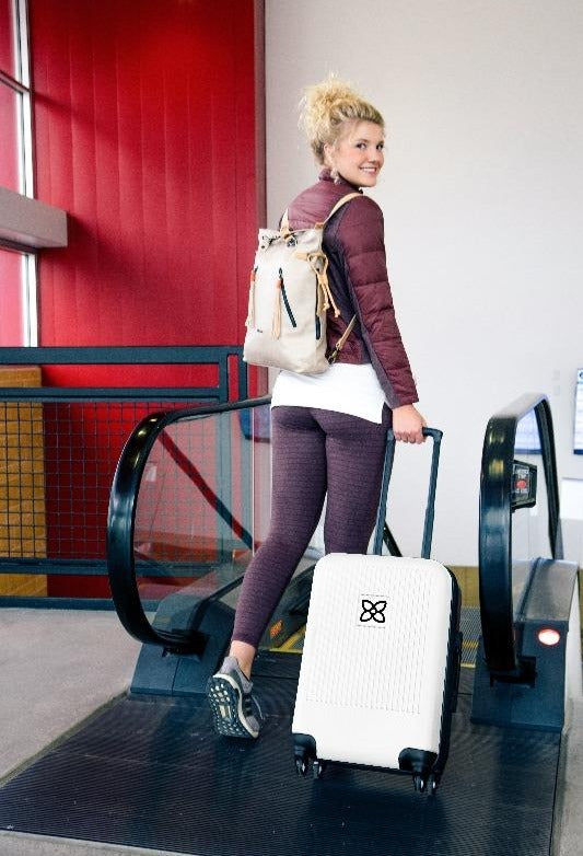 Meridian Carry-On Suitcase (On model) in Travel Collection (White)