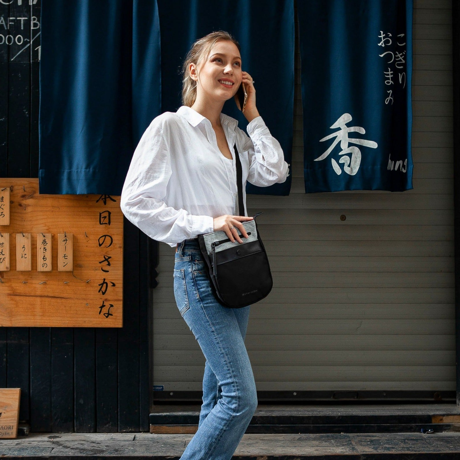 White Anti-theft Crossbody with anti-theft features on a woman on street