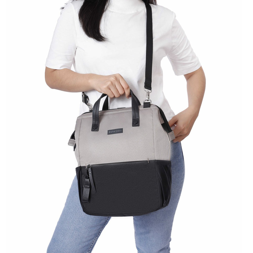 Light tan Handbag/Crossbody/Backpack (worn as a crossbody) made with recycled materials