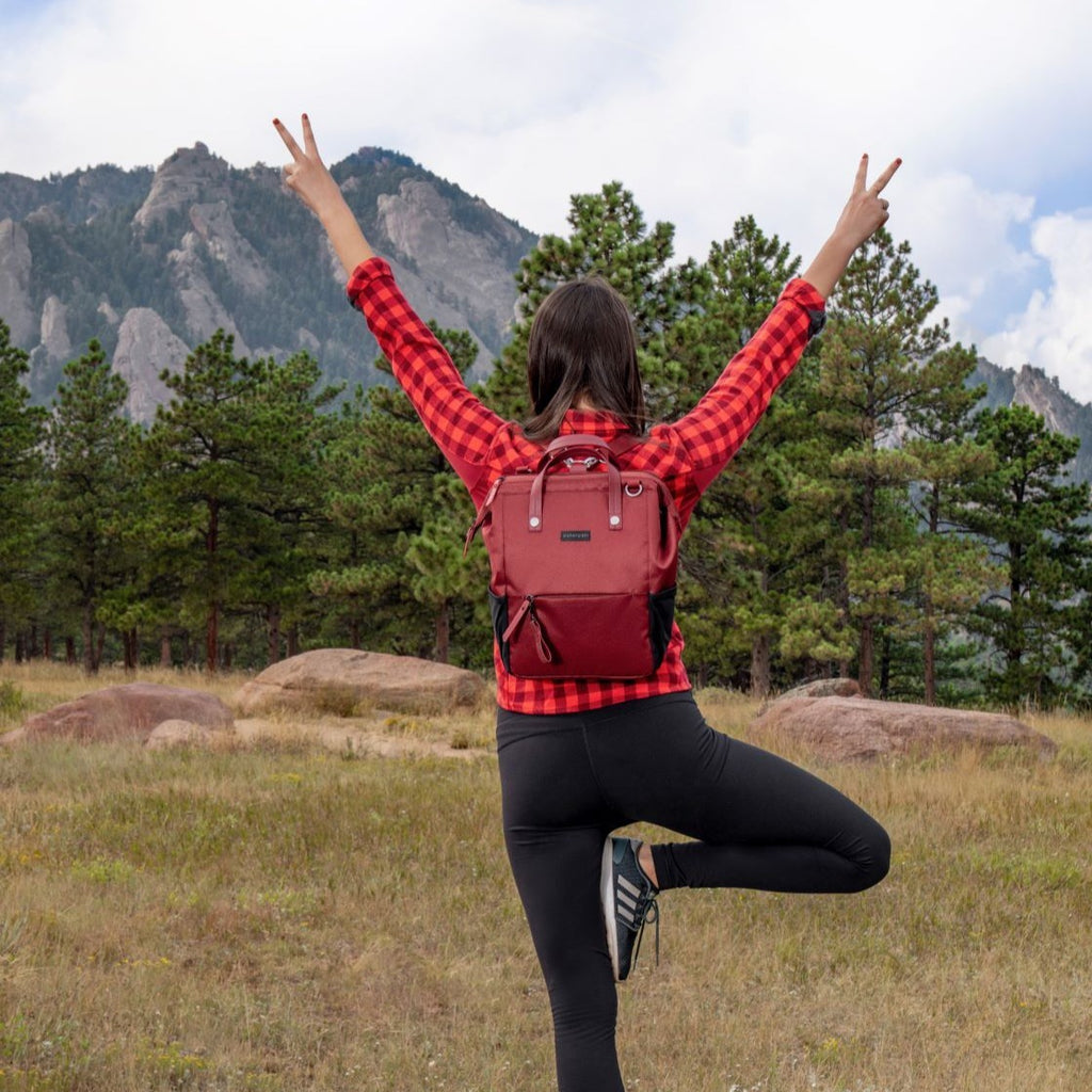 Red Handbag/Crossbody/Backpack made with recycled materials for a camping day