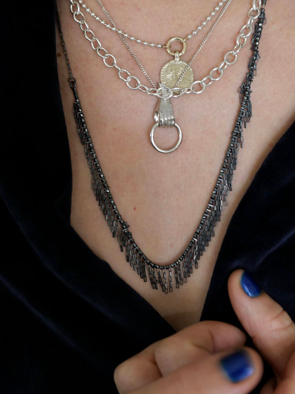 Falling strands black silver necklace