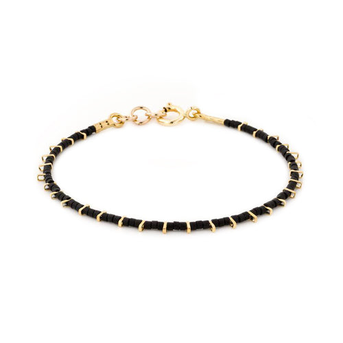Gold single kis bracelet