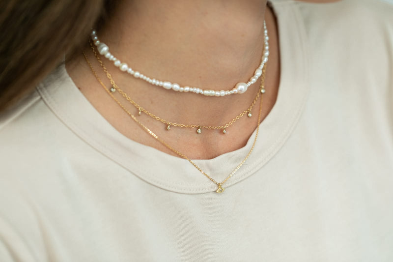 14k gold short necklace with falling diamonds