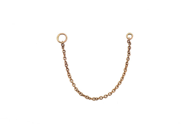 14k gold chain connects 2 earrings