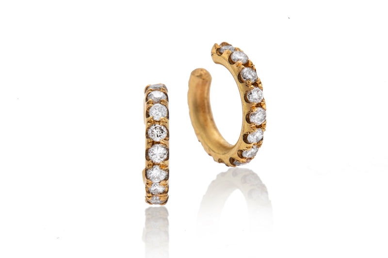 14k gold embracing earring with white diamonds