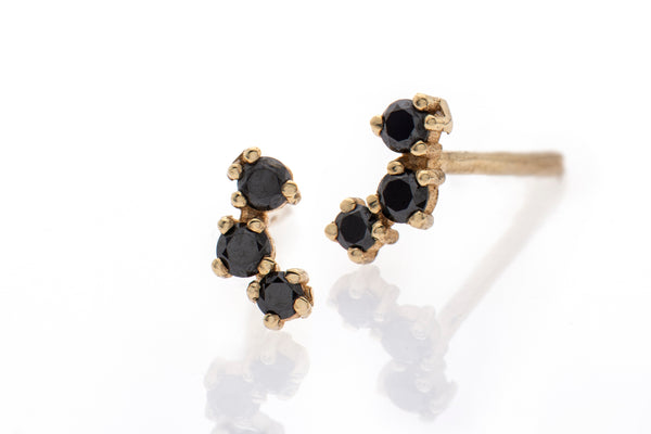 14k gold earrings with 3 black diamonds