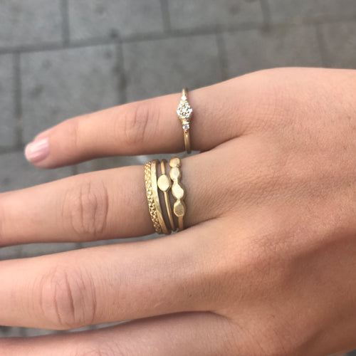14k gold ring with four flat circles
