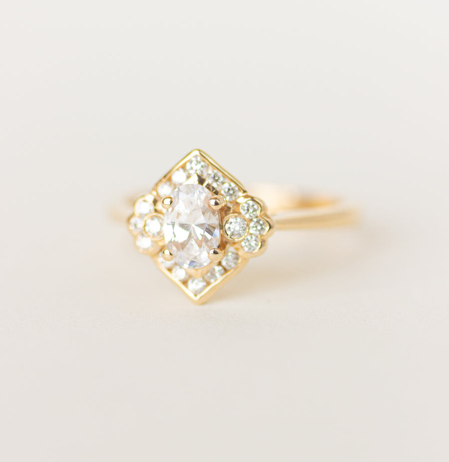 Vintage Inspired Engagement Ring with oval moissanite