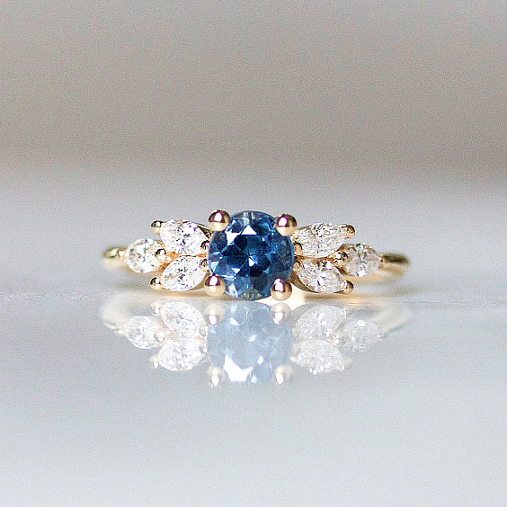 EVA Ring- Teal Sapphire Engagement Ring- Three marquise cut diamonds on either side set atop 14k yellow gold.