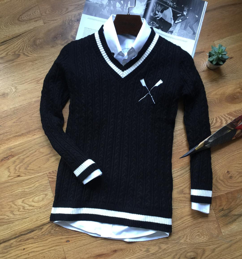 Adé Lang  black crossed white oar sweater in cable-knit pattern