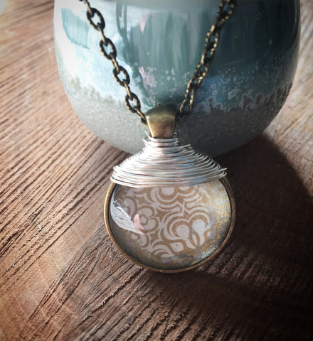 Cream and gold vintage style pendant on an antique bronze Long chain.