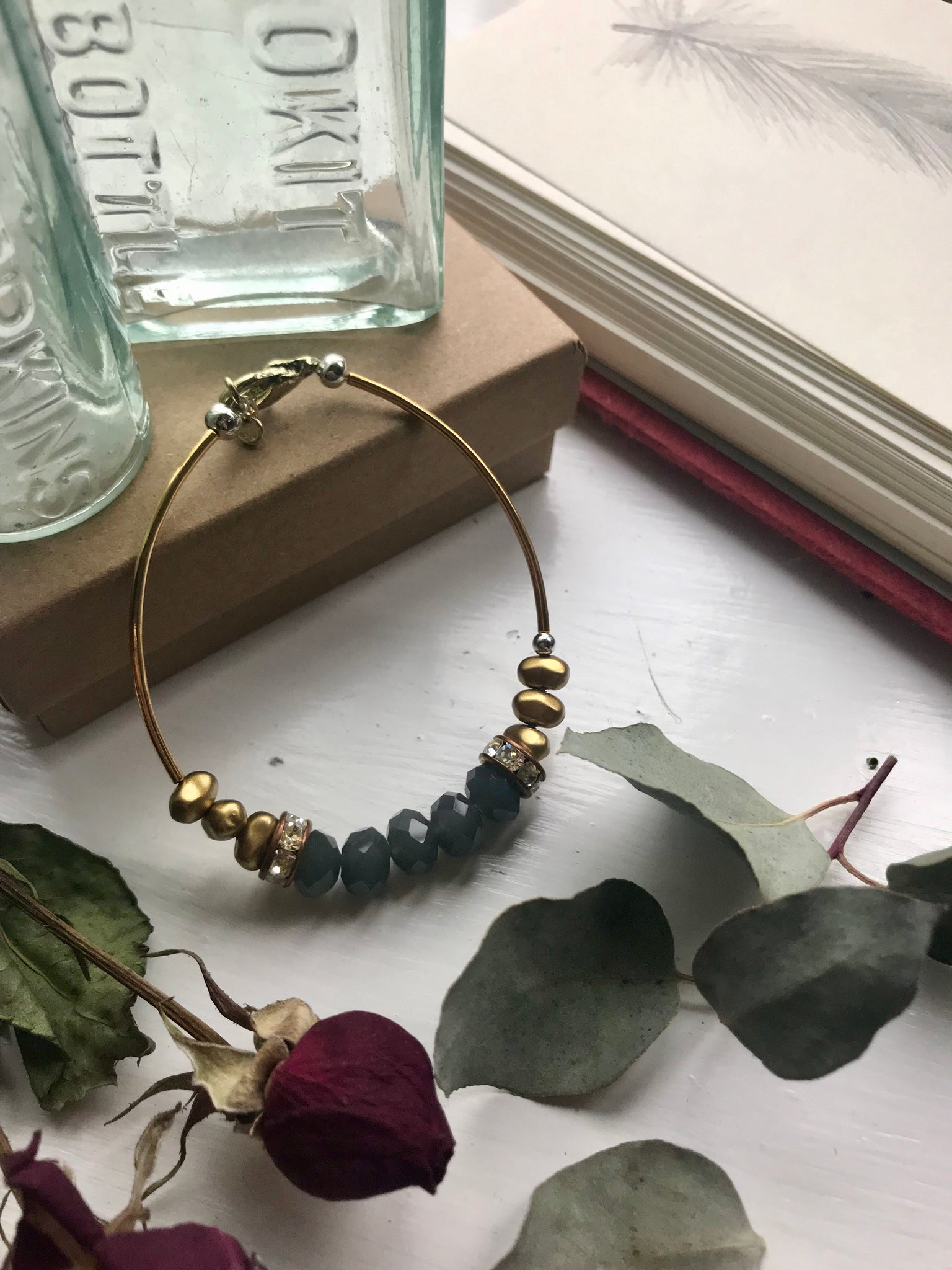 Gold, silver and blue tone bracelet